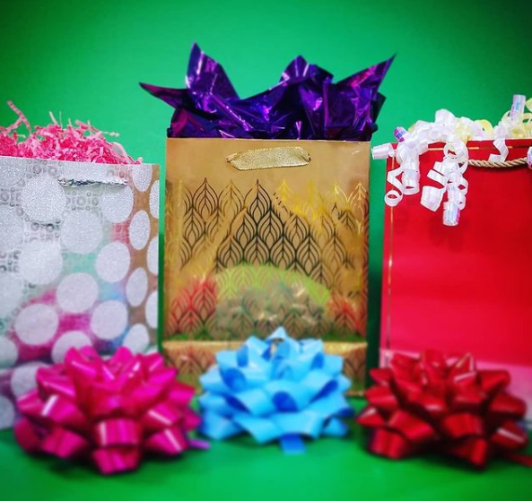 gift bags bows and wrapping paper